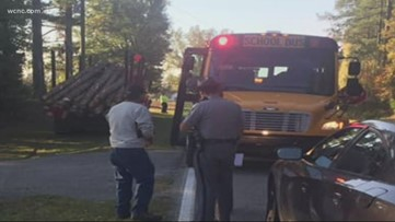 Caught On-Camera: Logging truck narrowly misses student boarding bus