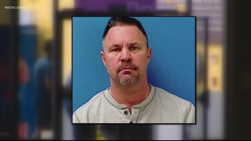 Man arrested after woman finds hidden camera in tanning bed room