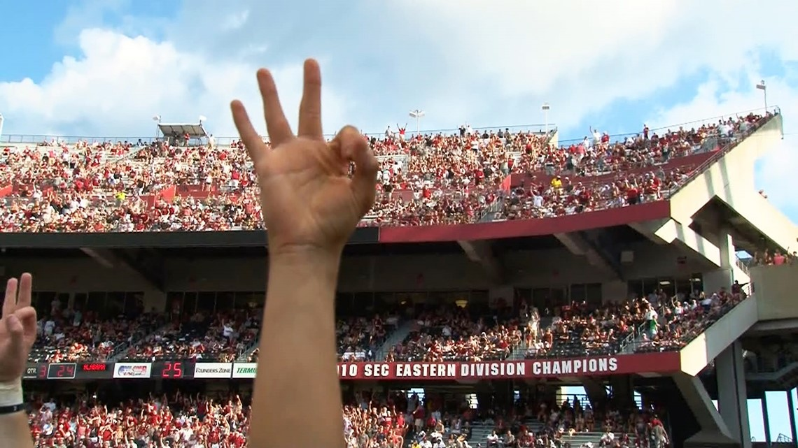 South Carolina fans throw up three fingers in love, support