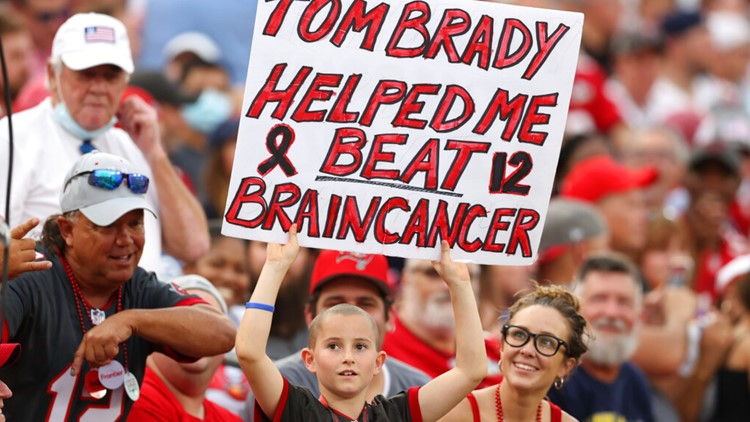 Tom Brady shares game hat with young fan who beat brain cancer