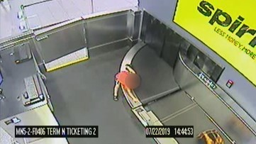 Video: Child climbs onto baggage conveyor belt at Atlanta airport, rescued