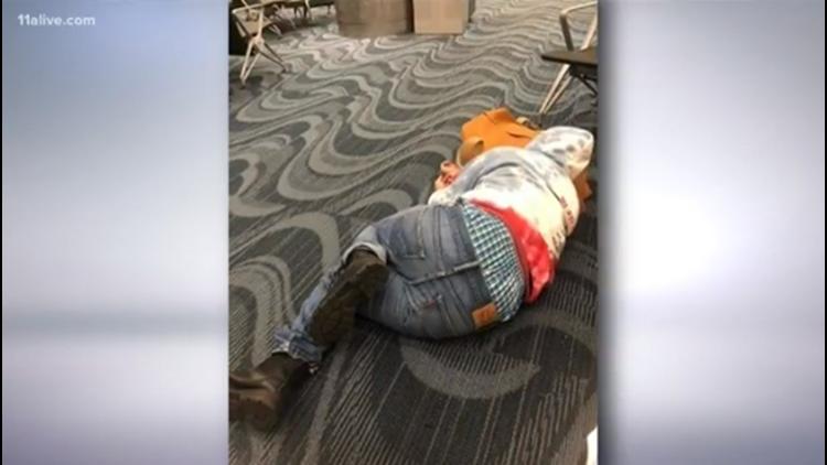 Sleeping on floor at Hartsfield-Jackson International Airport
